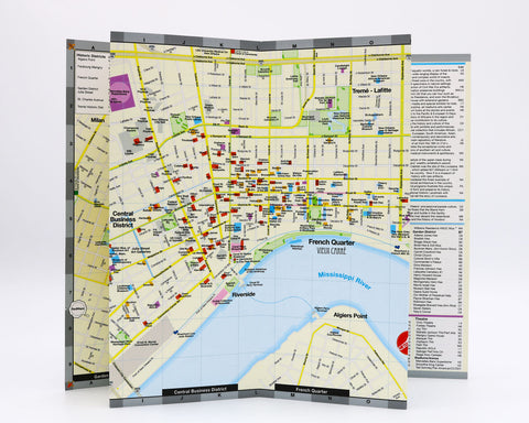 A folded city map of New Orleans that shows the shopping, hotels and restaurants of the historic French Quarter and Downtown.