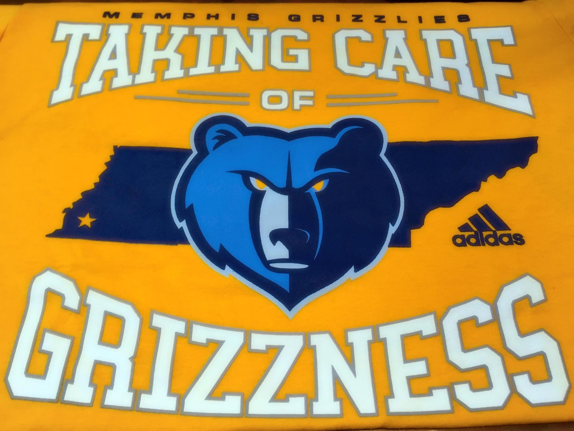 Adidas Memphis Grizzlies Taking Care of Grizzness Gold Tee 3720A 008