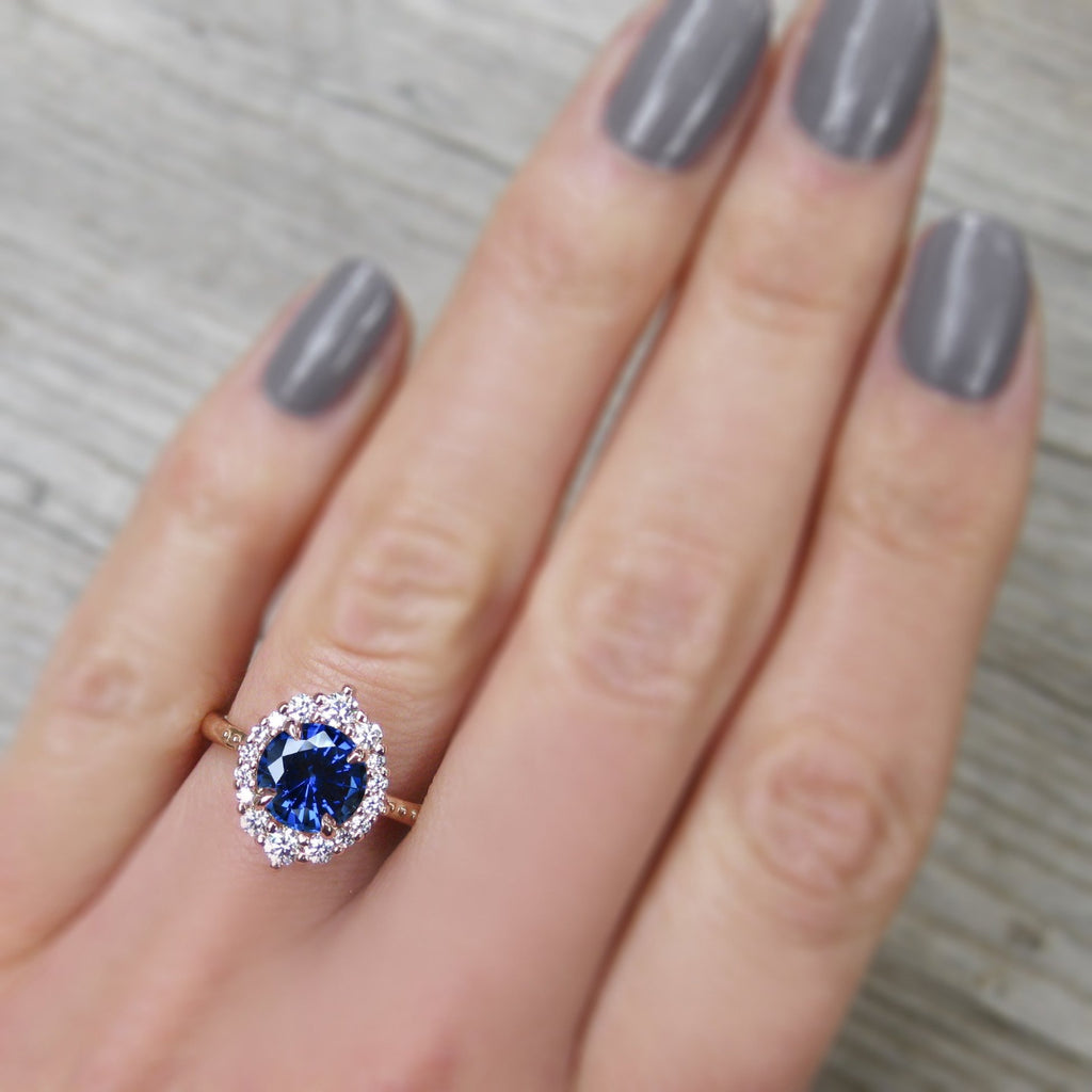 antique-inspired blue sapphire halo engagement ring in rose gold