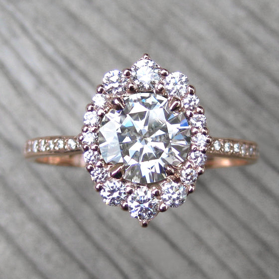 Top view of vintage-inspired halo ring with a conflict-free diamonds in 14k rose gold