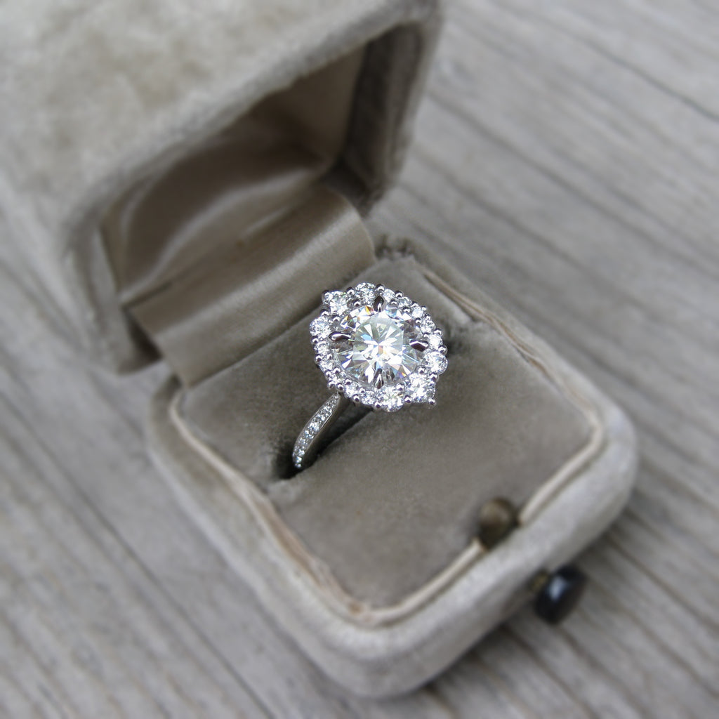 Moissanite halo engagement ring with diamonds in 14k gold modeled in engagement ring box