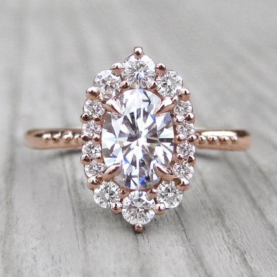 oval lab-created diamond halo engagement ring with a Canadian diamond halo in rose gold