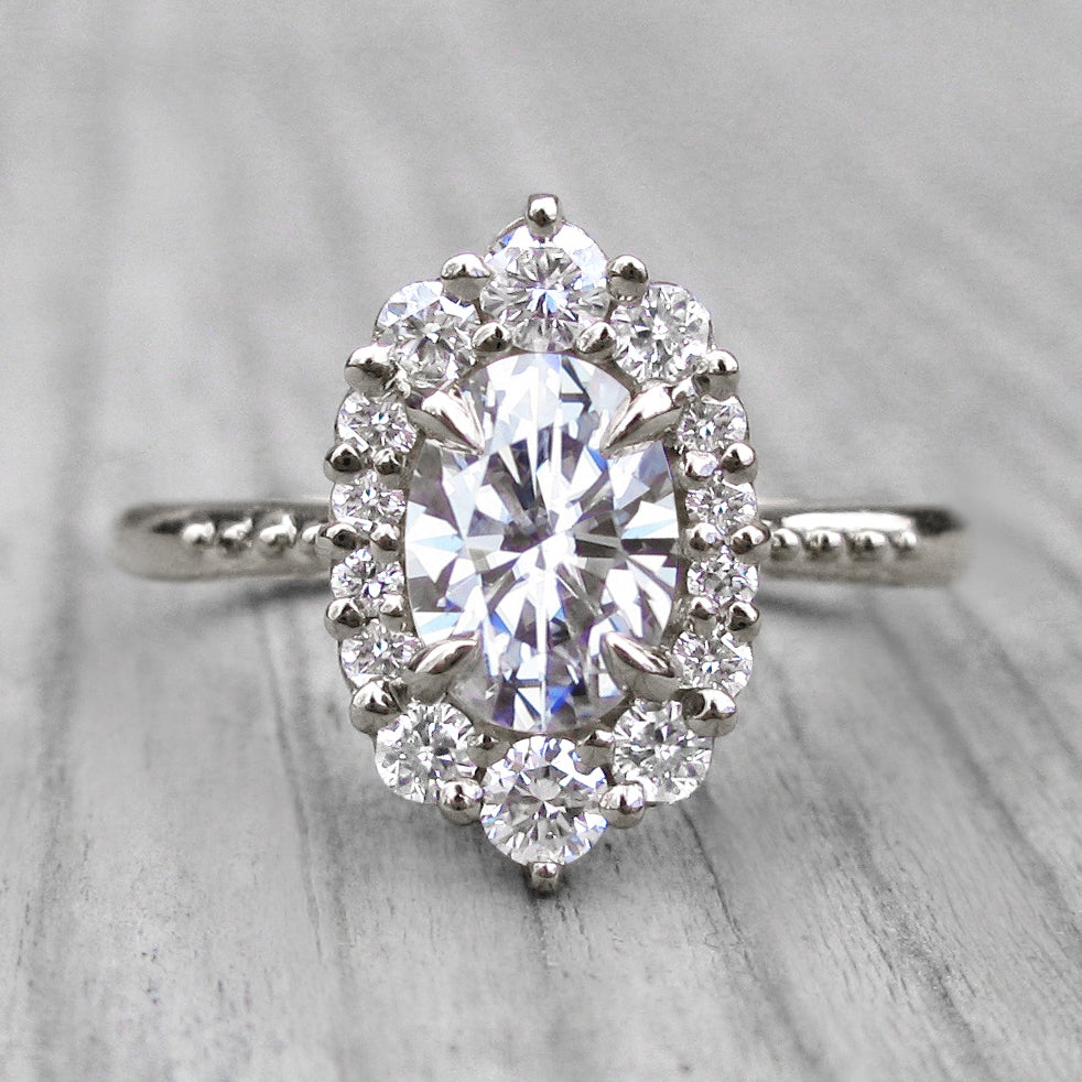 oval lab-created diamond halo engagement ring with a Canadian diamond halo in white gold