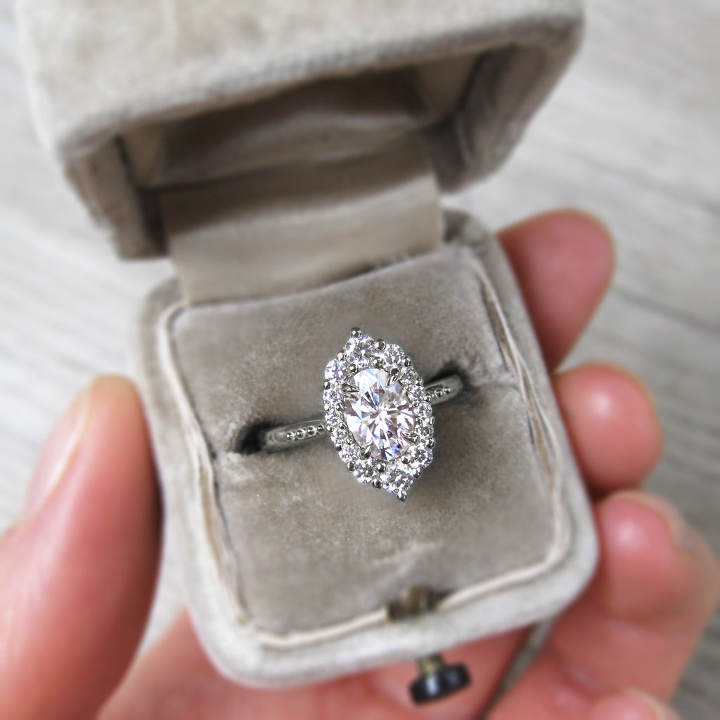 vintage-inspired and low-profile oval lab-created diamond halo engagement ring with a Canadian diamond halo in white gold