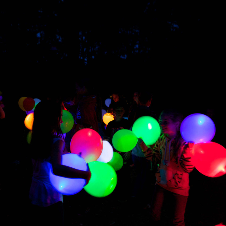 people with luminous Balloons