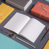 A6 Layflat Notebook open flat to reveal plain pages