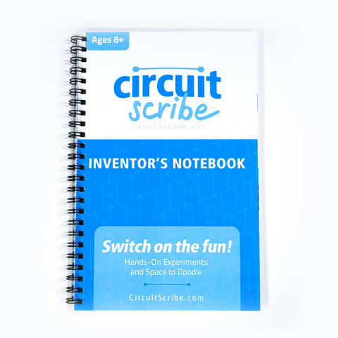 The Circuit Scribe Inventors Notebook with circuit projects on a white background.