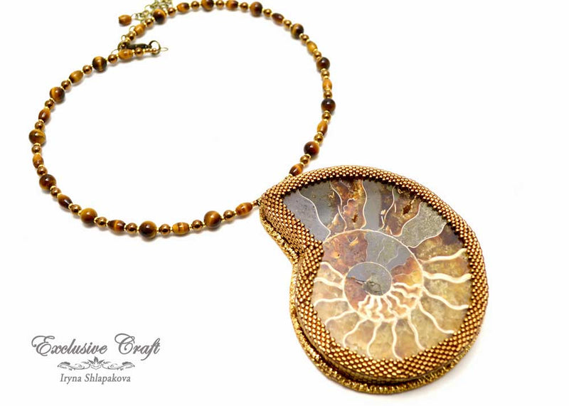 large ammonite beaded pendant