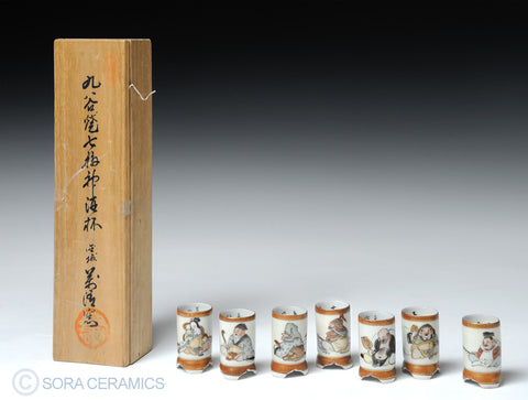 saki cups, shot glass shape, white with polychrome figures