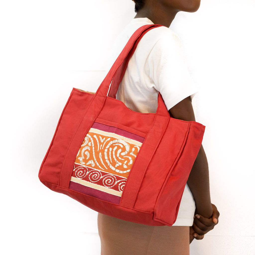 Hand-made safari Hand Bags in red colours