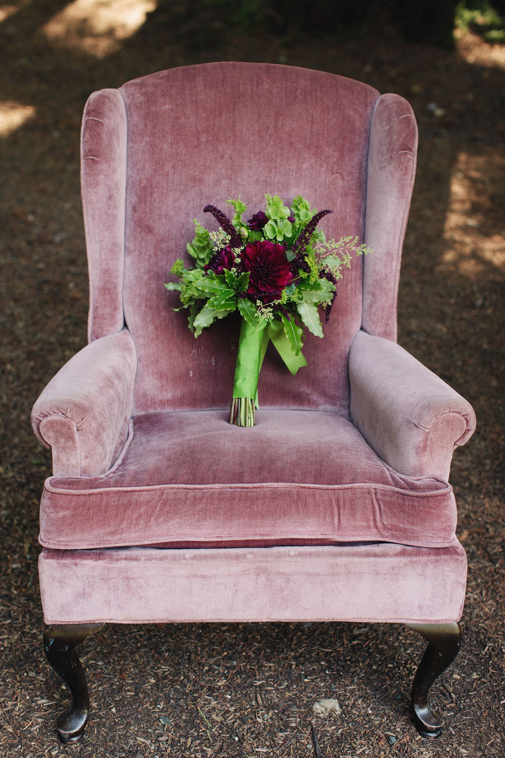 Vintage chair with mossy and dramatic bridal bouquet by Gorgeous and Green
