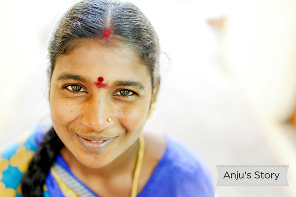Indian woman wearing blue sari and smiling