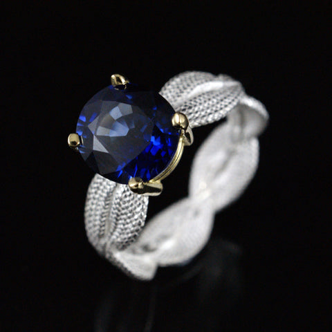 silver braid ring with 18ct yellow gold setting and sapphire, price available on request