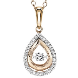 14k white and rose gold diamond pendant. Watch the center diamond sparkle with the slightest movement.