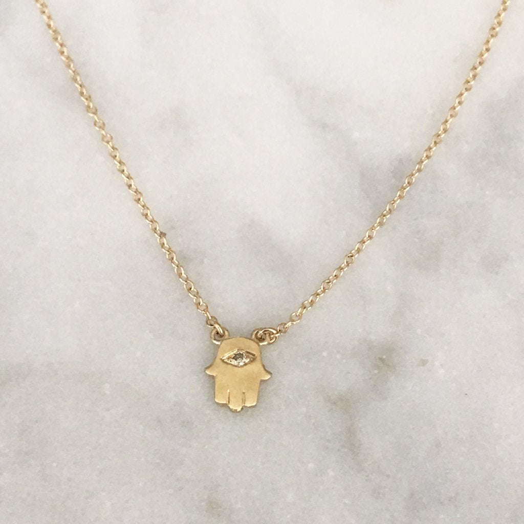 SOLID GOLD HAMSA WITH ONE TINY DIAMOND NECKLACE