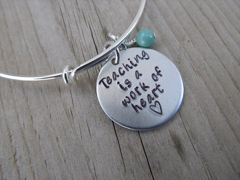 "Teacher's Bracelet, Gift for Teacher ""Teaching is a work of heart"" with a heart  - Hand-Stamped Bracelet- Adjustable Bangle Bangle Bracelet with an accent bead of your choice"