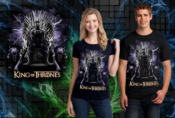 A woman and man wearing a black t-shirt with art inspired by Black Panther from Marvel sitting on a throne