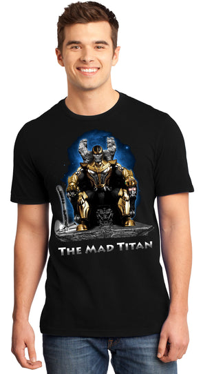 A man smiling while wearing a black t-shirt with an image in the likeness of Thanos from Marvel sitting on a throne