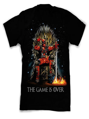 A black t-shirt with an image in the likeness of Deadpool sitting on a bronze thrown stepping on a helmet