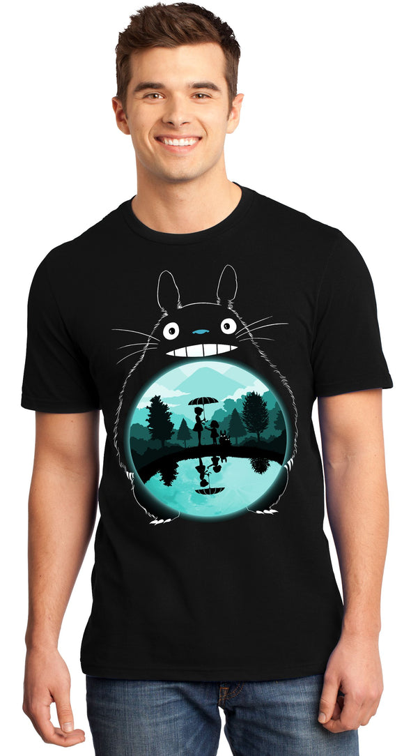A man smiling while wearing a black t-shirt with image in the likeness of Totoro from My Neighbor Totoro