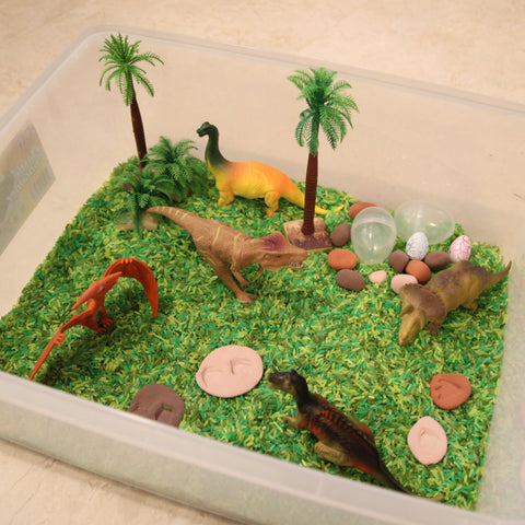 Dinosaurs colored rice play set
