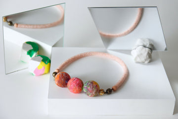 Swirl necklace in blush