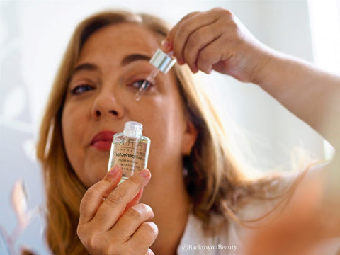 Sharon - Back to you beauty, applying ARK Skincare's Radiance Serum
