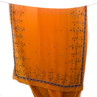Orange chiffon recycled sari with elaborate beads, sequins, and stones.