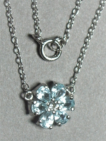 Blue Topaz Flower Pendant set in .925 Sterling Silver with Sterling Silver Cable Chain