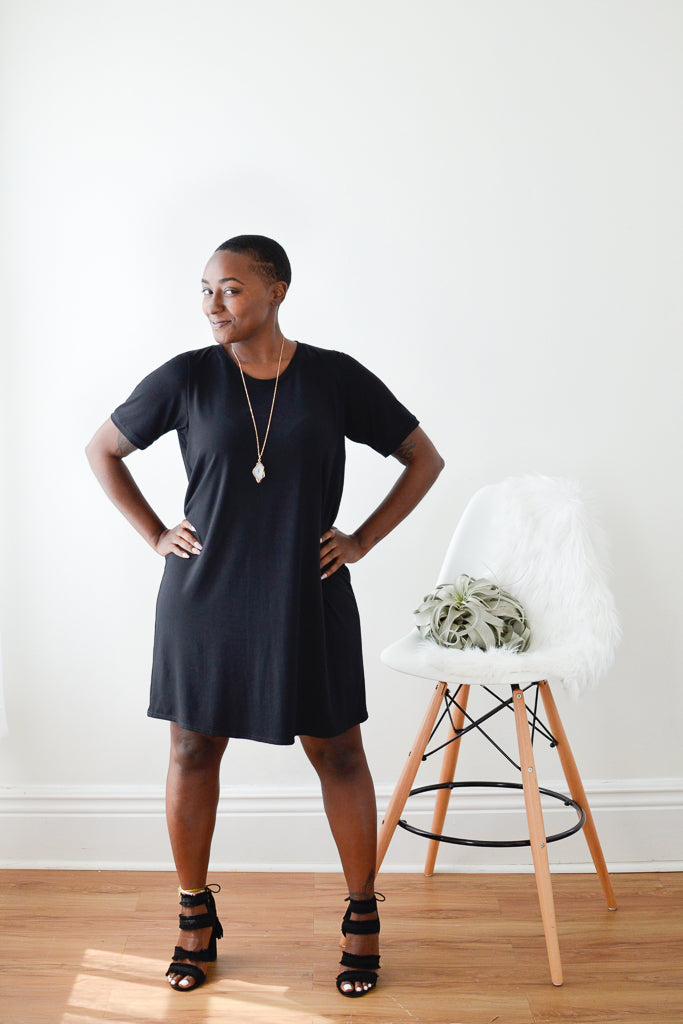 young woman in a black t-shirt dress