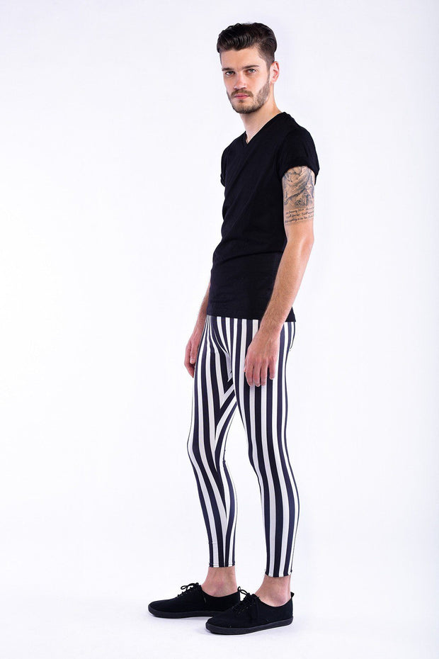 Man posing  in Kapow Meggings Black and white striped men's leggings side view