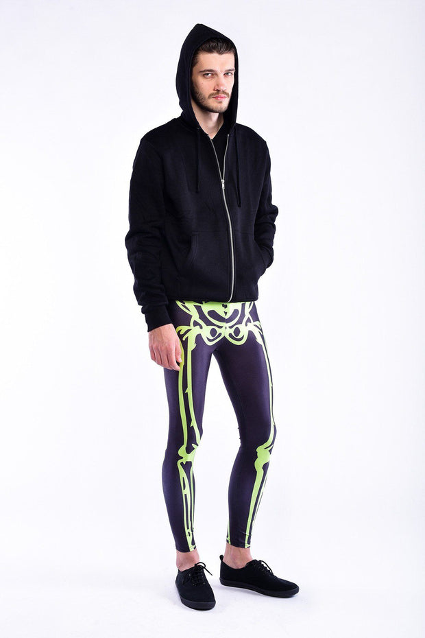 Man posing  Kapow Meggings neon green skeleton men's legging one side view