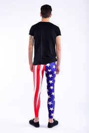 Man posing in Kapow Meggings USA flag blue white and red men's leggings from behind