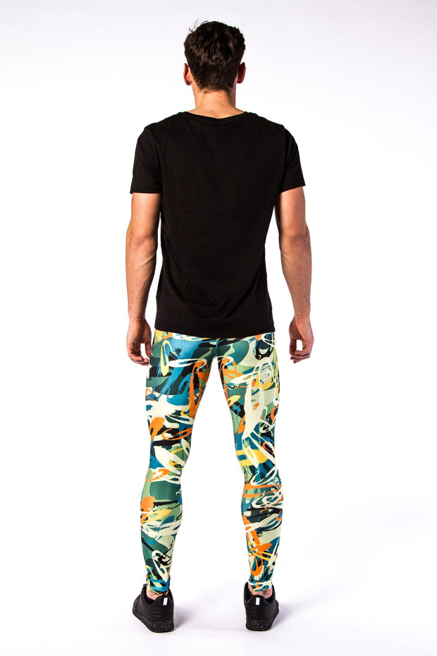 Man posing in Kapow Meggings graffiti themed men's leggings from behind