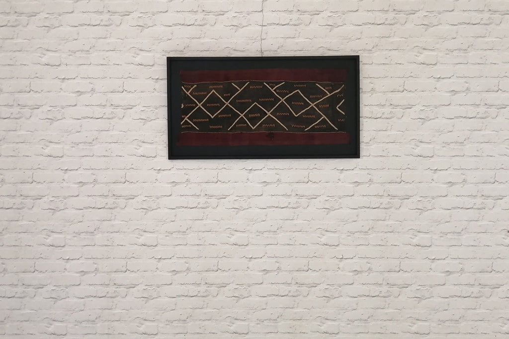 A beautiful piece of vintage Bakuba cloth, mounted and framed as wall art
