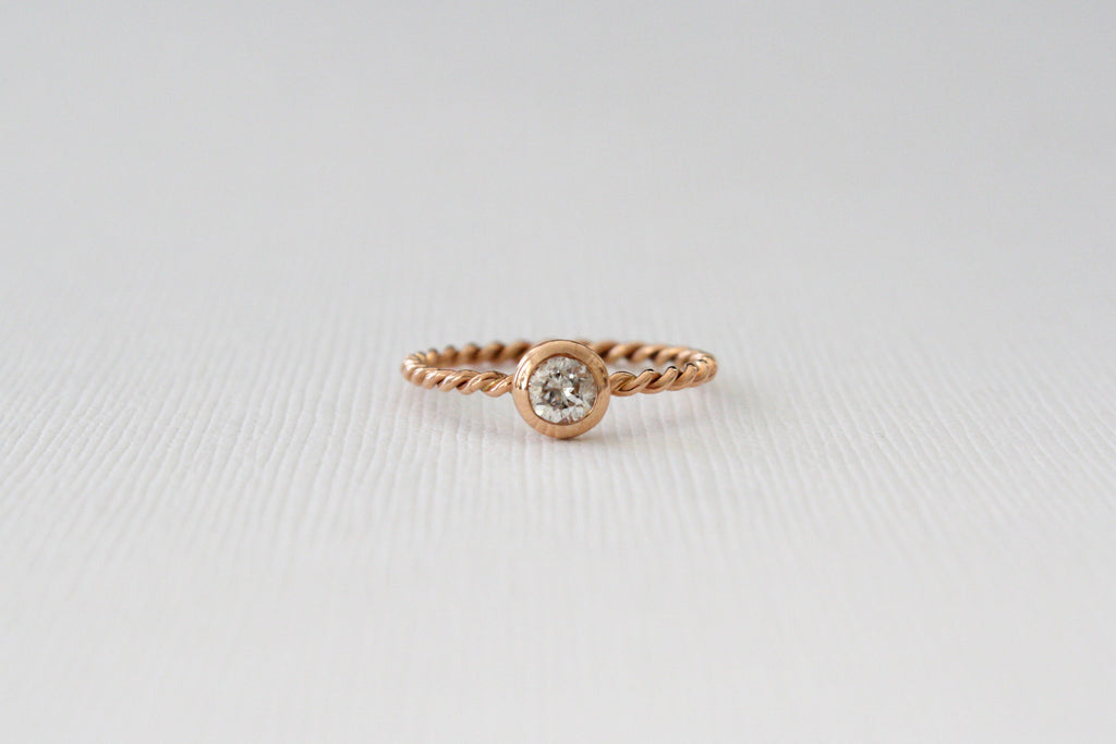 Solitaire Diamond Bezel Set Stacking Twist Ring in 14K Rose Gold