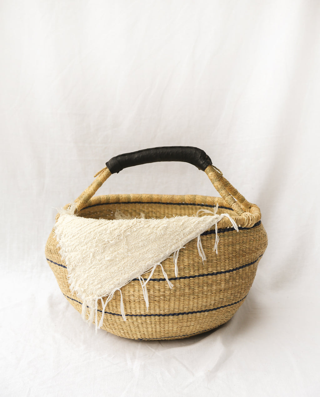 AKOSUA Round Straw Basket With Leather Detail Handles