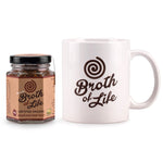 Small 45 gram jar of organic beef bone broth and a white Broth of Life ceramic coffee mug