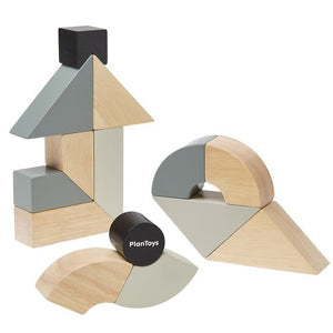 Grey, natural and black Twisted Blocks set by Plan Toys