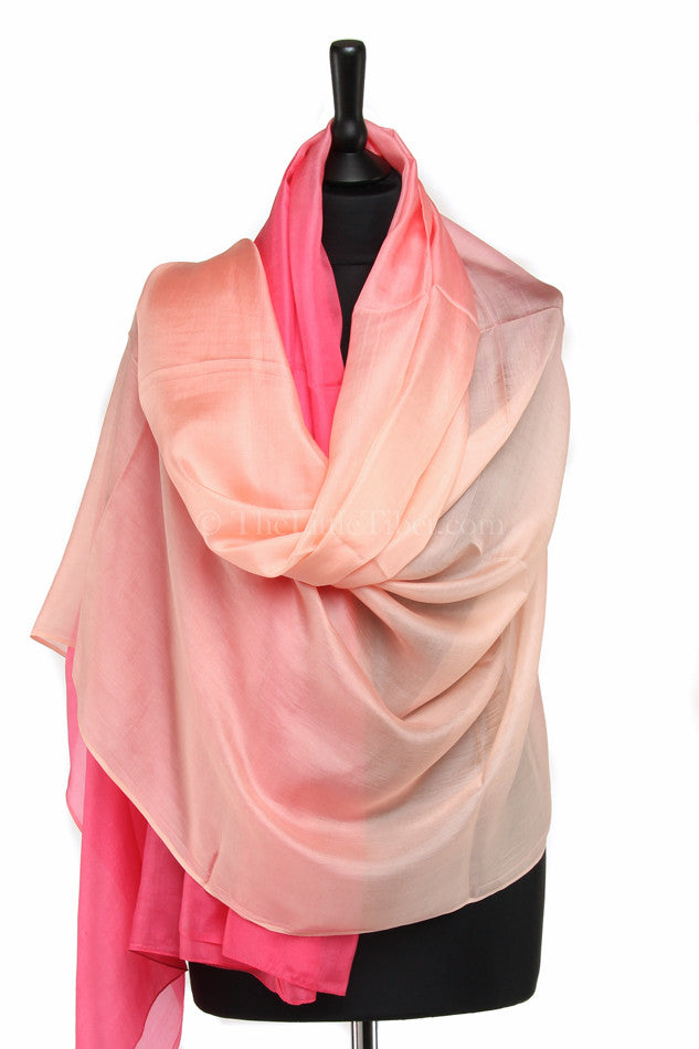 Luxury 100% silk scarf with ombre baby pink fluorescent detail draped around shoulders