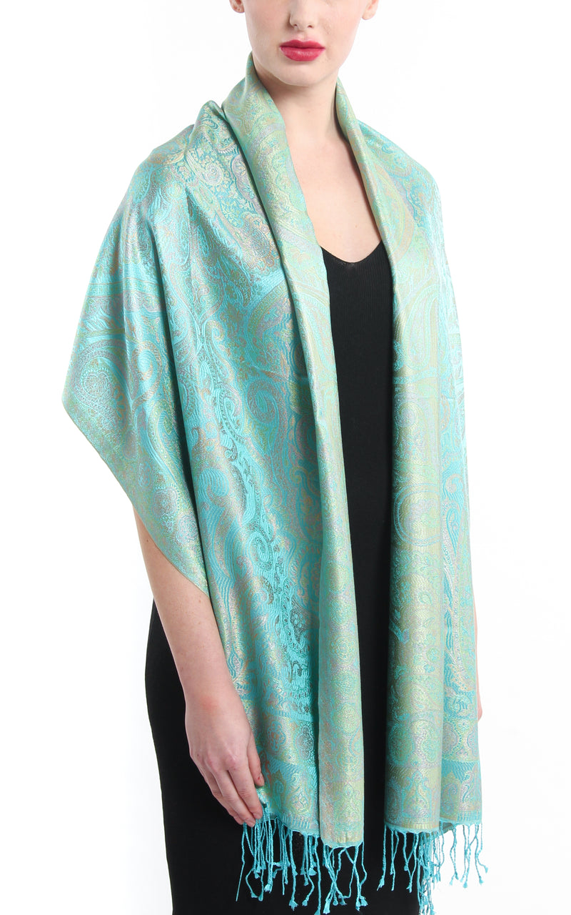 turquoise reversible pure silk paisley scarf draped over shoulder