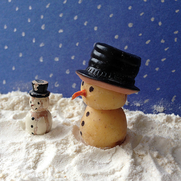 Potato snowman characters in winter