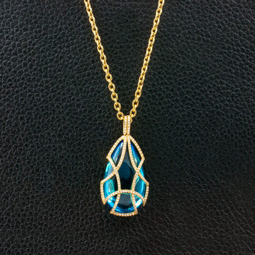 Diamond Tear Drop Cage Necklace with Blue Topaz Insert