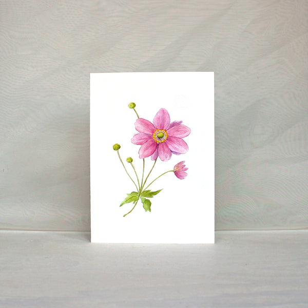 Note card with a watercolour painting of a pink Japanese anemone flower. Artist Kathleen Maunder.