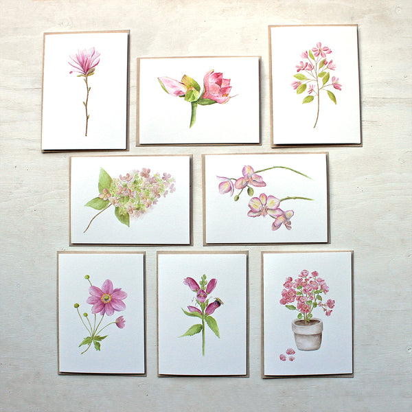 Set of eight pink floral note cards featuring: star magnolia, amaryllis, crabapple, hydrangea, orchid, Japanese anemone, turtlehead and pink begonia. Painted in watercolor by Kathleen Maunder.