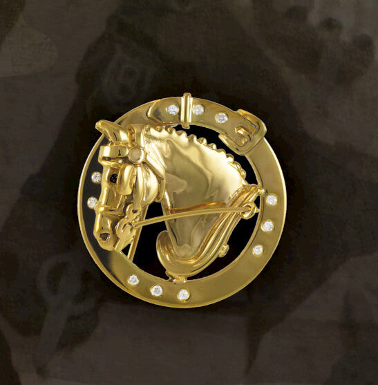 14k driving horse pin. Copyright and design by Lesley Rand Bennett