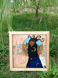 black goddess painting under a tree by Lea K. Tawd