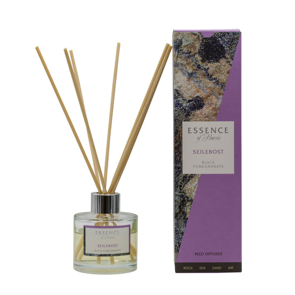 Clear glass reed diffuser with Seilebost scented liquid with natural reeds packaged in our Essence of Harris purple Seilebsot diffuser box
