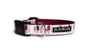 Boho Feathers Dog Collar with feathers in shades of burgundy, pink, and orange on a white background