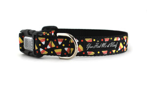 The Candy Corn Dog Collar in all black with small glittered candy corns and tiny orange dots.